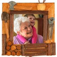 Деревенская рамка с целью снимок - Топоры, пилы, лопата равным образом дрова